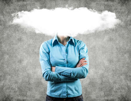 angry face: Photo of the girl with a white cloud on a head Stock Photo