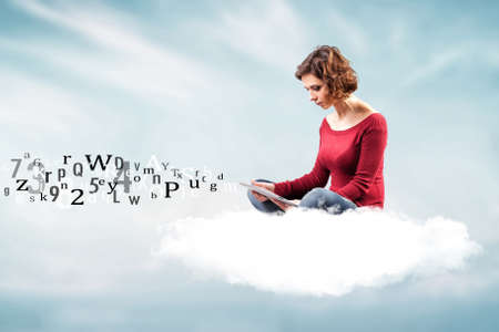 the girl with a computer on a cloud photo
