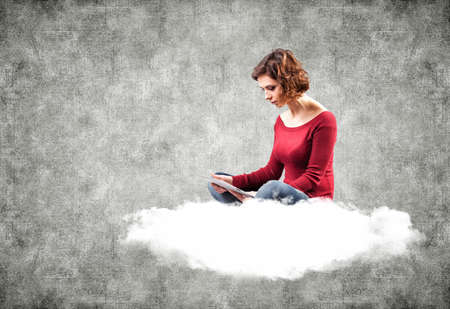 girl with a computer on a cloud photo
