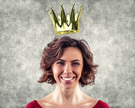 Beautiful girl with a gold crown over a head photo