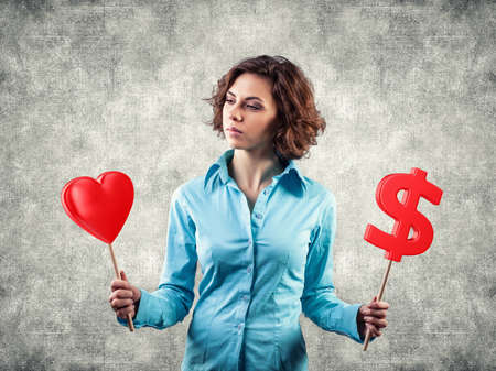 Beautiful girl chooses between money and love photo