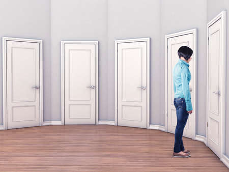 unclear: Girl before a white doors in fear of the unknown Stock Photo