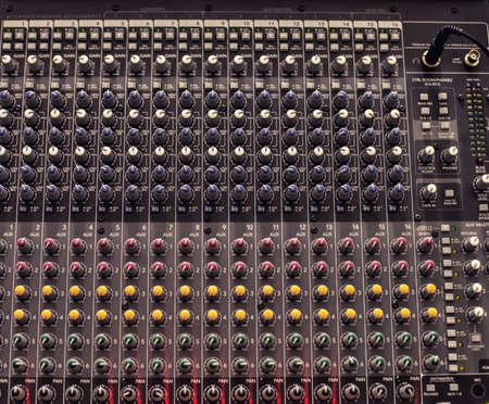 regulators: Audio fader with many regulators of different colour