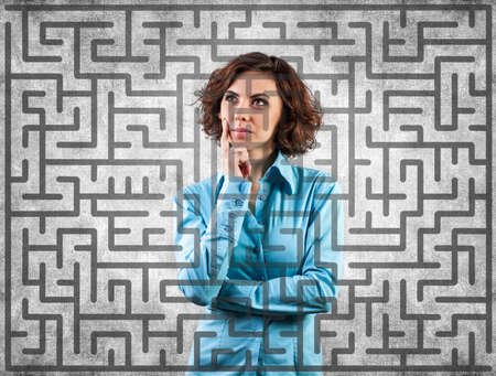 hard to find: Photo of the girl before a difficult labyrinth