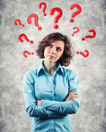 Red questions round a head of the beautiful girl Stock Photo - 18692856