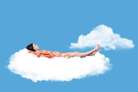 Beautiful girl, sleeping on a white cloud photo