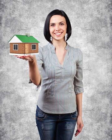 Photo of the girl with a house in a hand Stock Photo - 18936177