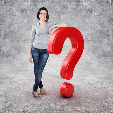 Beautiful girl stand with big question symbol photo