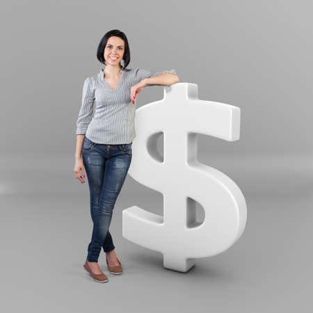 Beautiful girl stand with a big dollar symbol Stock Photo