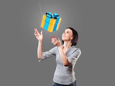 Girl looks at a beautiful gift with a hook Stock Photo - 19425281