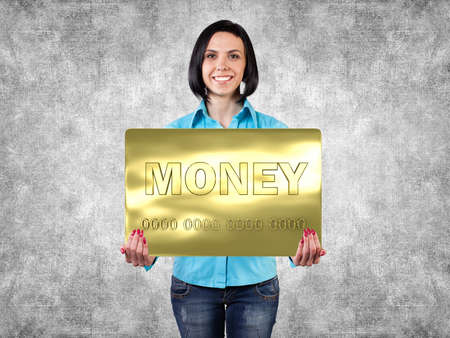Smiling girl with a big card in hands Stock Photo - 19811479