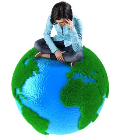 Sad girl sits on small planet Earth