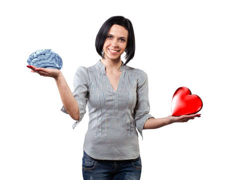 Beautiful girl chooses between brain and love Stock Photo