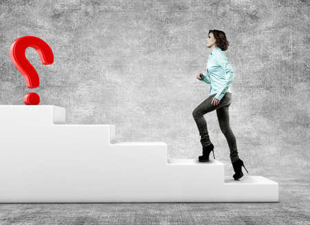 The girl rises upwards on a ladder to questionmark Stock Photo