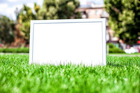 notice board: Photo of a announcement board on a green grass Stock Photo