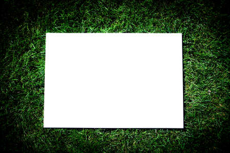Photo of a announcement board on a green grass photo