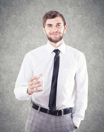 The young man with a glass tells a toast Stock Photo