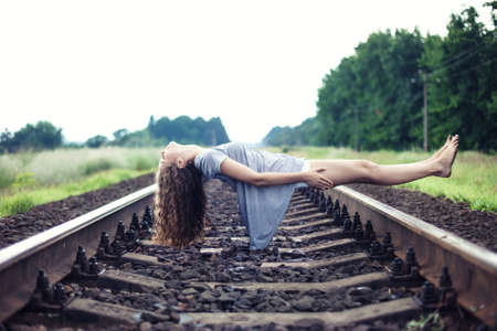 levitation: The beautiful girl flies over the railway Stock Photo
