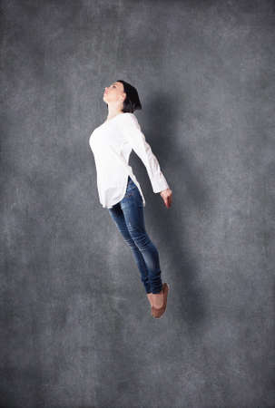 free thought: The beautiful girl flies highly in a jump Stock Photo
