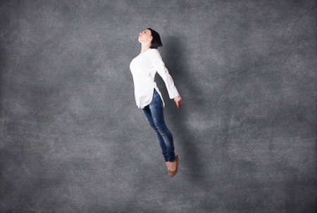 freedom of thought: The beautiful girl flies highly in a jump Stock Photo