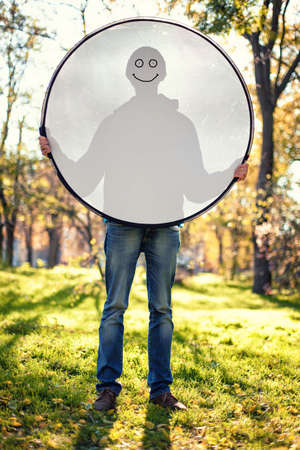 reflector: Boy holding a reflector with a silhouette of his figure