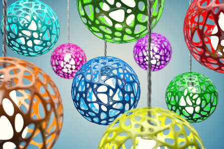 hangs: Chandeliers of different colour hang on a wire