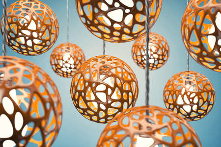 lampshade: Chandeliers of orange colour hang on a wire Stock Photo