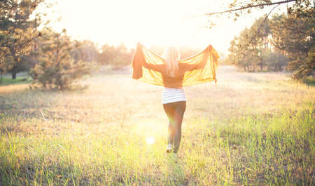 coverlet: The beautiful girl with a scarf walks in forest