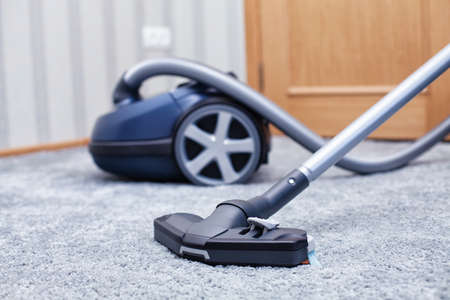 dirty carpet: The new vacuum cleaner lies in a room