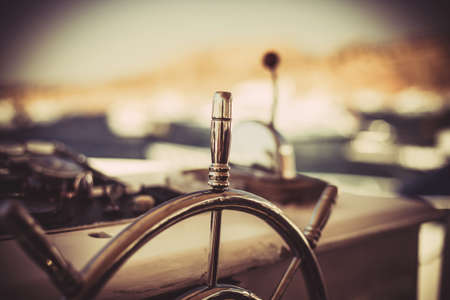 Photo of a wheel for navigation on the yacht Stock Photo