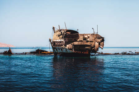 corrosion: Photo of the old and rusty sunk ship Stock Photo