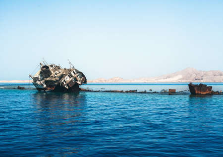 sunken boat: Photo of the old and rusty sunk ship Stock Photo