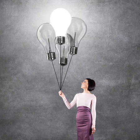 ascend: Girl with lightbulbs in the form of balloons