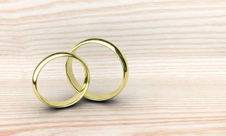 gold rings: Illustration of two gold rings on a wooden table