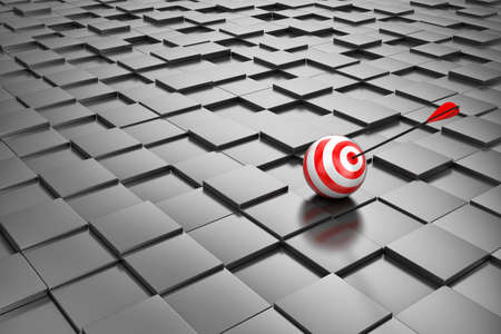 conceptual: Target with an arrow on set of cubes of black colour Stock Photo