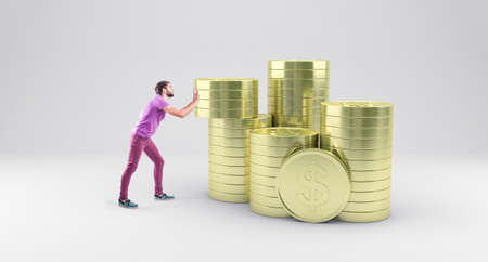 pulling money: The young boy pushes gold coins to one pile Stock Photo