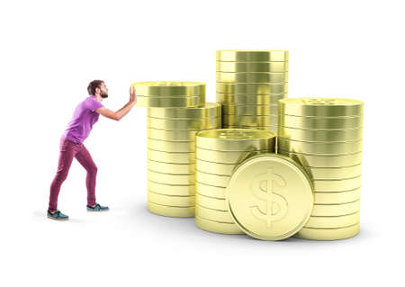 coin: The young boy pushes gold coins to one pile Stock Photo