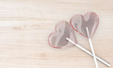 sweety: Illustration of two red lollipops on a wooden table Stock Photo