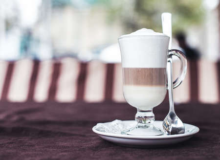 glass cup: Photo of the cup with latte on a table Stock Photo
