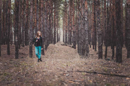 woman alone: Photo of a beautiful girl, located in the forest