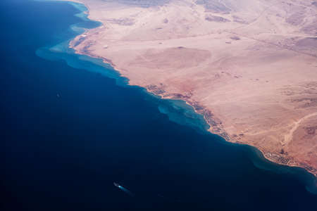 sea view: Photo of desert with sea and hot climate