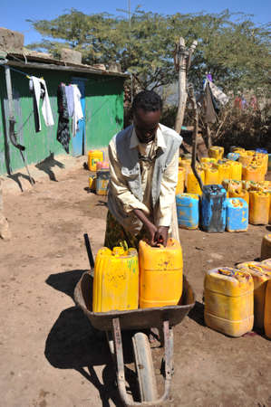 Point of delivery of water in an African refugee camp  photo