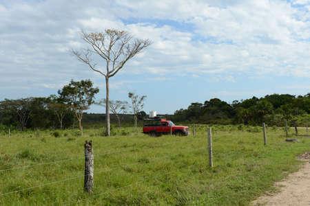 surrounding: The cars of tourists Surrounding the river Guayabero