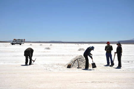 dried up: Salt production on the Uyuni salt flats, dried up salt lake in Altiplano.