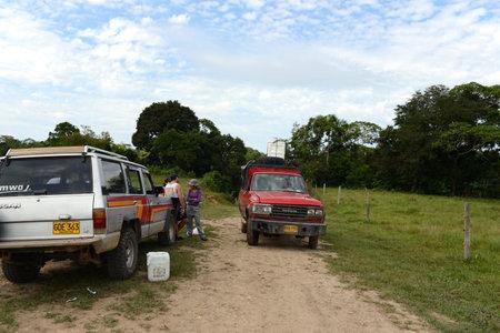 surrounding: The cars of tourists Surrounding the river Guayabero.
