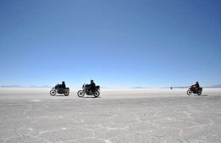 dried up: Tourists on the Uyuni salt flats dried up salt lake in Altiplano
