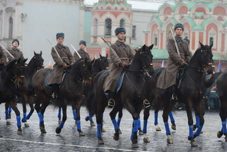 cavalry: Russian soldiers cavalry in the form of the Great Patriotic War at the parade on Red Square in Moscow.