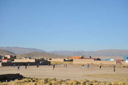 residents: Residents of a Bolivian mountain village playing football.