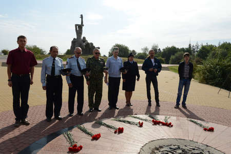 nazism: Laying flowers at the memorial Zmievskaya Balka - in memory of the victims of Nazism Editorial
