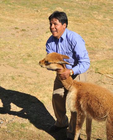 vicuna: Bolivian man with a vicuna